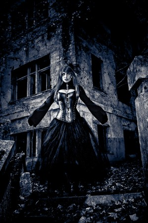 Woman in black dress from nightmare or fantasy Standard-Bild