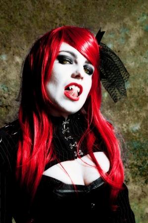 Sexy redhead vampire posing seductively Stock Photo
