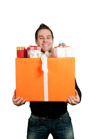 man shopping: Young man carrying a bunch of presents isolated on white Stock Photo