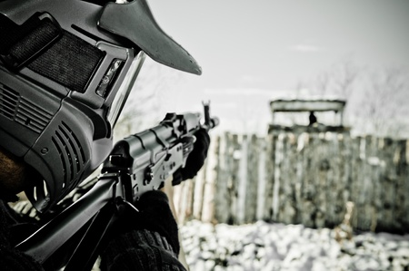 Airsoft player aiming at the tower