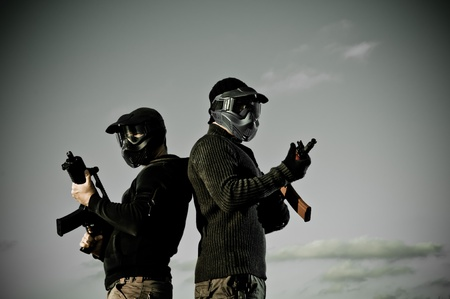 Two men with airsoft masks holding rifles Stock Photo