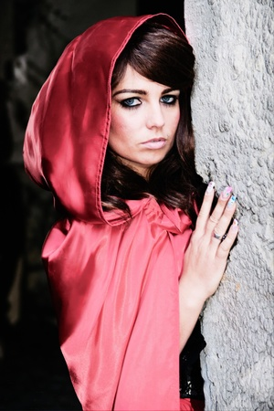 Beautiful girl with brown hair with red hood photo