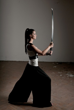 Beautiful woman holding a long shining steel ceremonial sword Stock Photo - 12107009