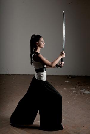 Beautiful woman holding a long shining steel ceremonial sword Stock Photo - 12107009