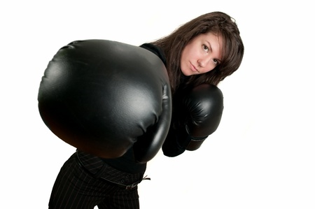 Young brunette girl with boxing gloves photo