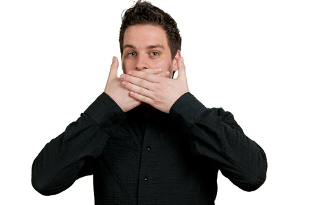 Man with his hands over his mouth and a shocked expression. photo