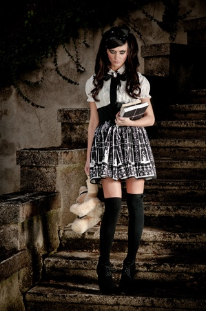 lolita: Adolescent beautiful Lolita schoolgirl looking forlorn and insecure as she exudes an air of precocious sexuality