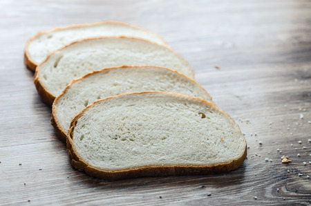 produits alimentaires: Fresh bread on wood background, Apartment will post pictures of bread on a wooden Board.