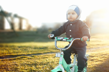 child on a bike, in the spring,cute little athlete