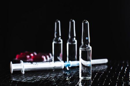 ampoules: On the table there are ampoules, next different pills,drugs and medications Stock Photo