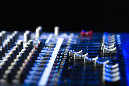 mixing console on a black background, musical instrument for scoring and mixing Stock Photo