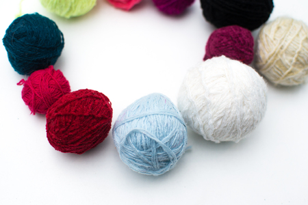 Set of colorful wool yarn balls. Hanks are set out in a pile. Stock Photo