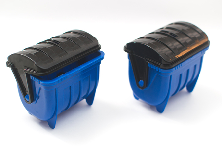 blue garbage containers for garbage on white background Stock Photo
