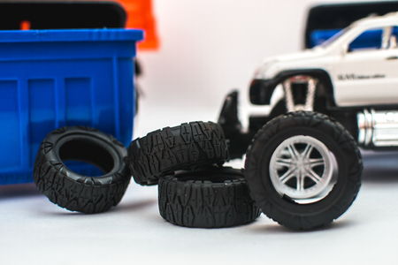 Near garbage containers on a white background are folded tires from the vehicle
