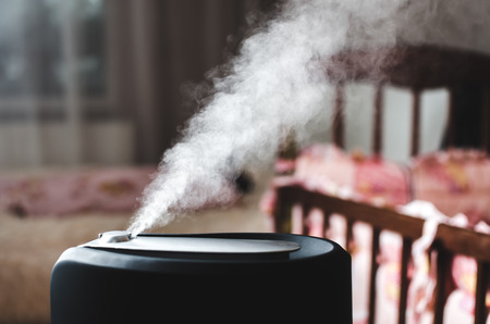 The steam from the humidifier night the bedroom, next to the crib Фото со стока - 93296953