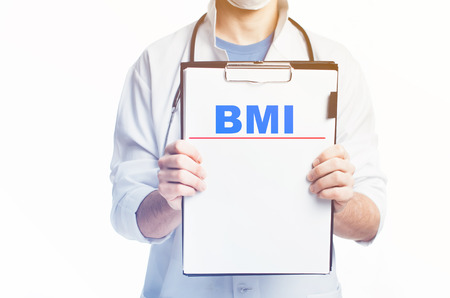 Doctor with a clipboard, blank template written diagnosis of BMI there is empty space Stock Photo