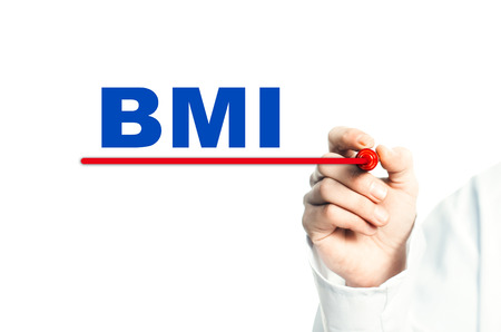 Hand draws a red line marker, emphasizes the important inscription medical BMI Stock Photo