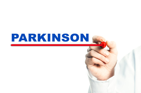 Hand draws a red line marker, emphasizes the important inscription medical PARKINSON Stock Photo