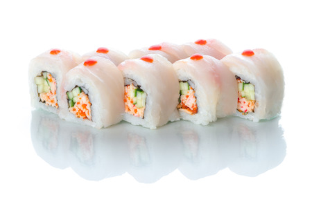 On white isolated background with reflection, sushi rolls red perch and snow crab uramaki white dragon
