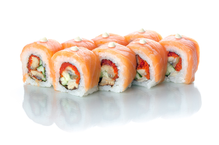On white isolated background with reflection, sushi rolls with eel and salmon with Japanese mayonnaise droplets