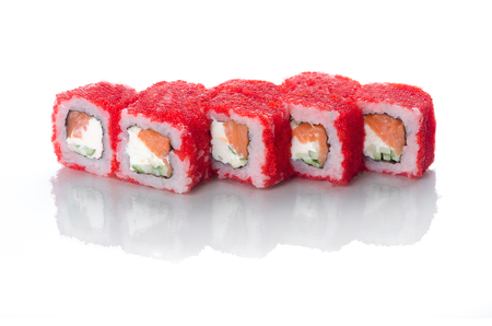 On white background isolated with reflection, sushi rolls red with caviar with eel and salmon with Japanese mayonnaise droplets Stock Photo