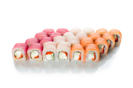 On white background isolated with reflection, sushi rolls Japanese cuisine beautiful lot set different