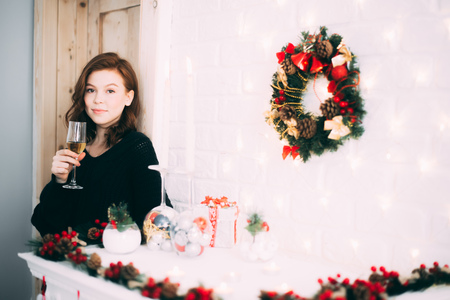 Beautiful girl with a glass of champagne, Christmas atmosphere, new year Stock Photo