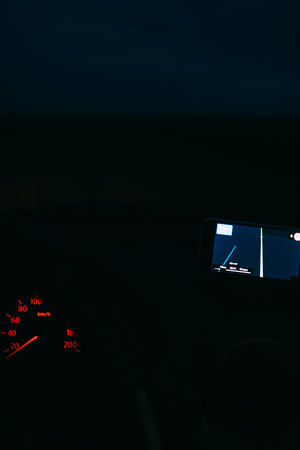 Night road in the car Navigator on the phone