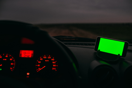 Night road in the car phone with a green background chroma key
