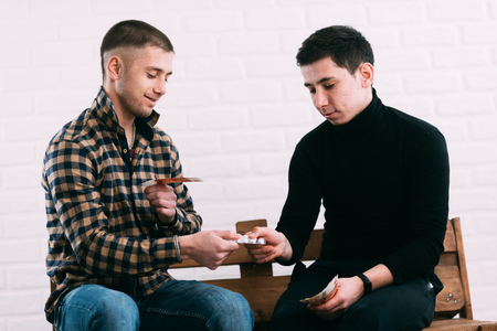 men on the bench selling drugs or pills for rubles