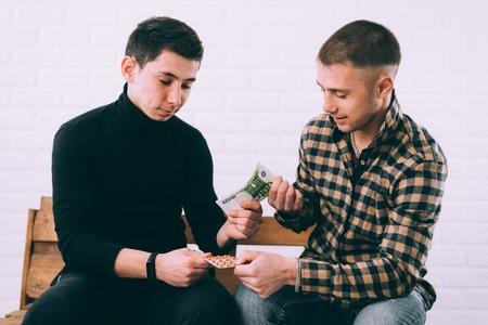 sale of drugs or drug money two men