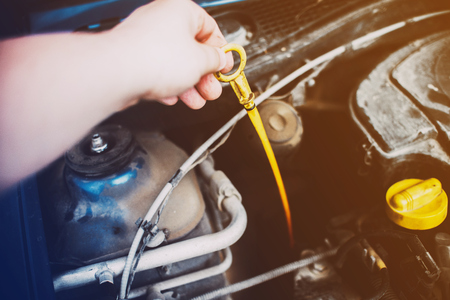 yellow nylon dipstick check oil level in car engine