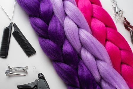 Kanekalon. Colored artificial strands of hair. Material for plaiting braids 版權商用圖片