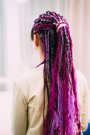teen girl with bright pigtails with purple thread Zizi 版權商用圖片