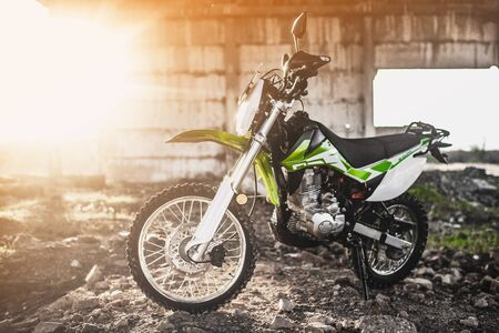 Beautiful green off-road motorcycle Enduro or cross, in a contoured light cool