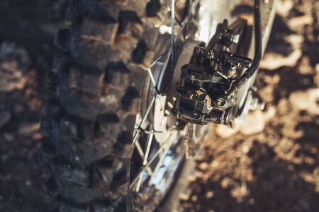 Close-up of disc rear brakes of off-road motorcycle enduro 版權商用圖片