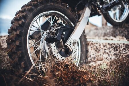 Action the wheel of an Enduro Motorcycle Hits an obstacle in the ground, dirt