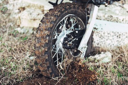 Action the wheel of an Enduro Motorcycle Hits an obstacle in the ground, dirt Stock fotó - 138464024