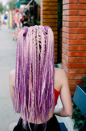 The girl with the pigtails Senegalese braids pink color, beautiful color cool