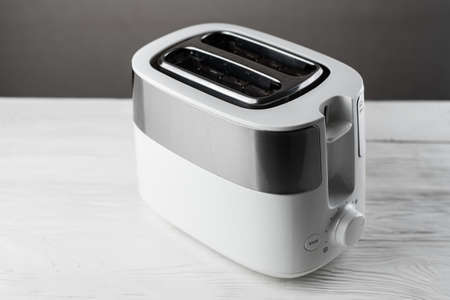White with silver toaster on gray background