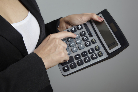 oversight: business woman hand calculator Stock Photo
