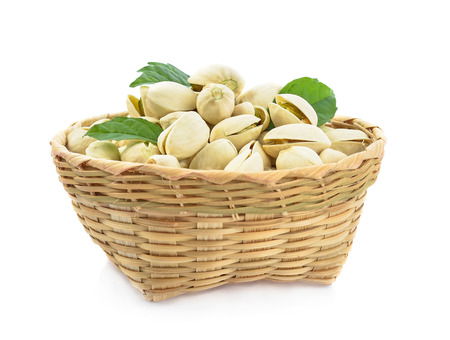 Pistachio in basket isolated on white background.