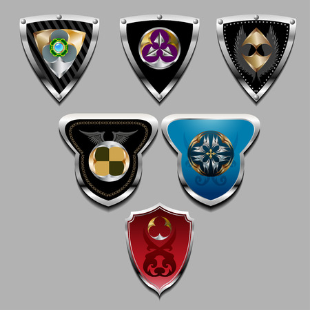 plated: Set of the steel plated shields with a various decorative pattern.