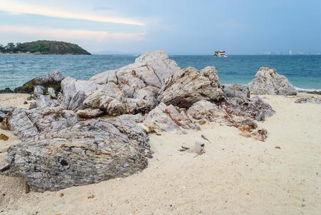 beach rain: Big stones on the beach beside island and city view when rain is coming Stock Photo