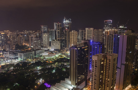 retail scene: Business city of Malaysia, Kuala Lumpur at night. Aerial night view Stock Photo