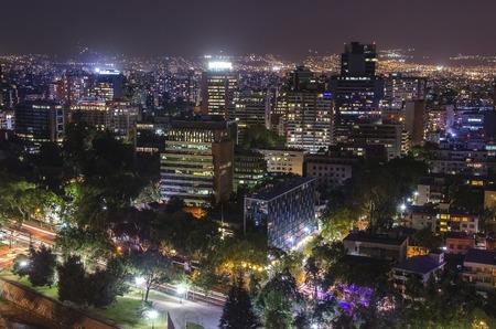 The skyline of Santiago de Chile by night. Фото со стока