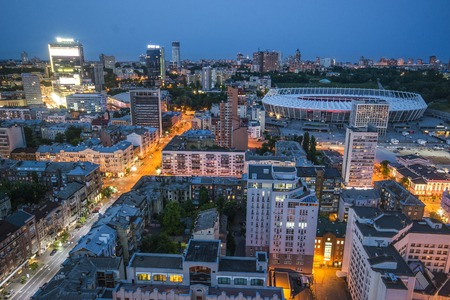 KYIV, UKRAINE - JUNE 18: Olimpiyskiy stadium Kiev, aerial view from the top on 18 June 2016. Night view of city center Kiev.