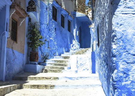 Street with stairs in Medina of Chefchaouen, Morocco. Chefchaouen or Chaouen is known that the houses in this old town are painted in the striking, variously blue hued