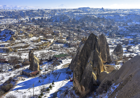 Cappadocia. Turkey. View from mountain on the unusual winter landscape with cliffs at morning time