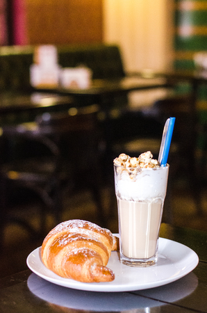 Chocolate Frappe and Frappuccino on wood table. Coffee with croissant